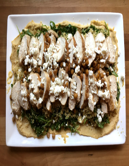 Rose Reisman Chicken over hummus with salad
