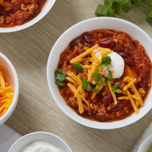 Beef and Barley Chili with Aged Cheddar and Sour Cream