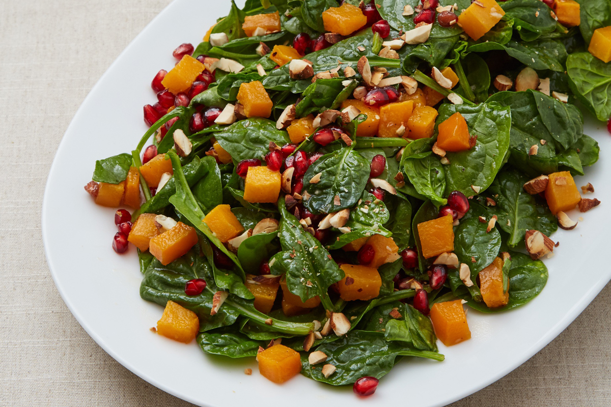 Spinach Salad with Toasted Almonds, Butternut Squash, and Pomegranate Seeds