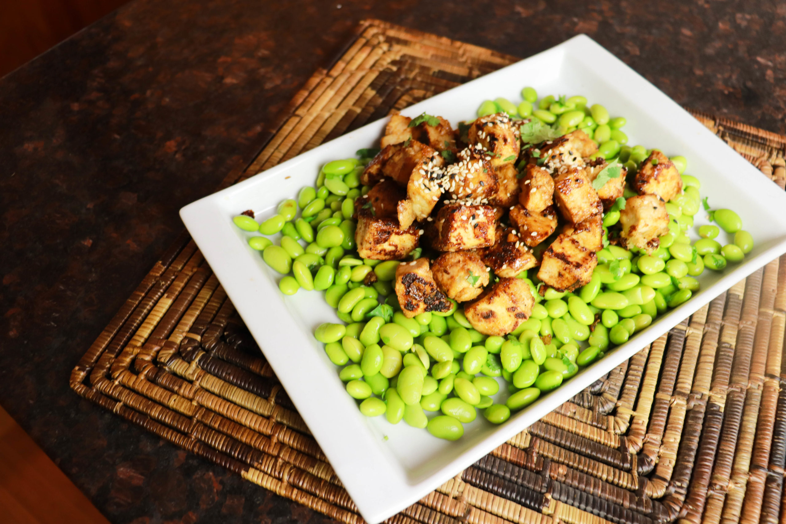 Crispy tofu with maple soy glaze over edamame